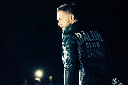 finn-balor-wearing-his-balor-club-jacket-in-an-nxt-event